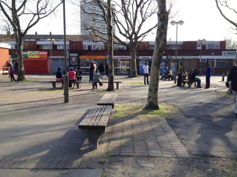 Local people gather in the square next to Thames Christian College