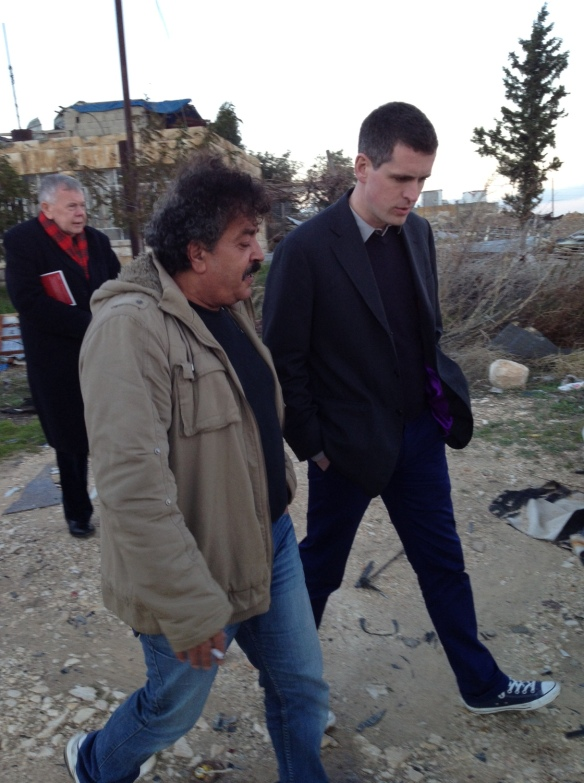 Salim shows Simon Hogg around Fidhdat Square in Anata