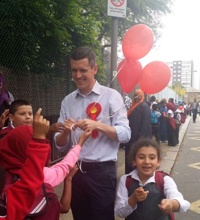 Simon Hogg hands out balloons at Chesterton School